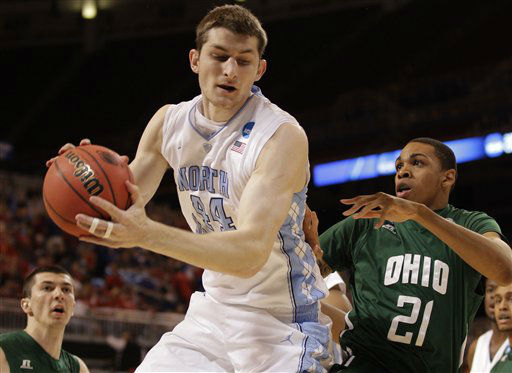 North Carolina forward Tyler Zeller &#40;44&#41; grabs a rebound against Ohio forward Jon Smith &#40;21&#41; during the first half of an NCAA tournament Midwest Regional college basketball game Friday, March 23, 2012, in St. Louis.  <span class=meta>(&#40;AP Photo&#47;Charlie Riedel&#41;)</span>