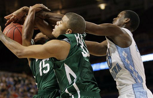 Ohio guard Nick Kellogg &#40;15&#41;, forward Reggie Keely &#40;30&#41; and North Carolina forward Harrison Barnes &#40;40&#41; battle for a rebound during the first half of an NCAA tournament Midwest Regional college basketball game, Friday, March 23, 2012, in St. Louis.  <span class=meta>(&#40;AP Photo&#47;Charlie Riedel&#41;)</span>