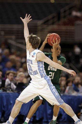 Ohio Bobcats forward Jon Smith moves around North Carolina Tar Heels&#39; David Dupont during the first half of an NCAA tournament Midwest Regional college basketball game Friday, March 23, 2012, in St. Louis.  <span class=meta>(&#40;AP Photo&#47;Charlie Riedel&#41;)</span>