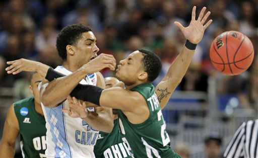 North Carolina forward James Michael McAdoo, left, is fouled by Ohio guard Stevie Taylor, right, in the first half of an NCAA tournament Midwest Regional college basketball game, Friday, March 23, 2012, in St. Louis. <span class=meta>(&#40;AP Photo&#47;Jeff Roberson&#41;)</span>