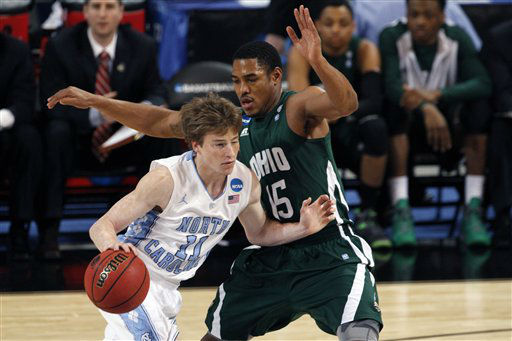North Carolina Tar Heels guard Stilman White is defended by Ohio Bobcats&#39; Nick Kellogg during the first half of an NCAA tournament Midwest Regional college basketball game Friday, March 23, 2012, in St. Louis. <span class=meta>(&#40;AP Photo&#47;Kiichiro Sato&#41;)</span>