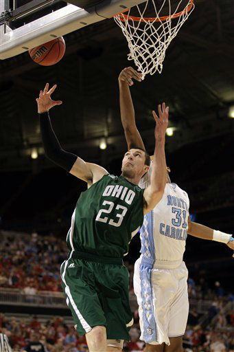 Ohio Bobcats forward Ivo Baltic and North Carolina Tar Heels forward John Henson go for a rebound during the first half of an NCAA tournament Midwest Regional college basketball game Friday, March 23, 2012, in St. Louis. <span class=meta>(&#40;AP Photo&#47;Charlie Riedel&#41;)</span>
