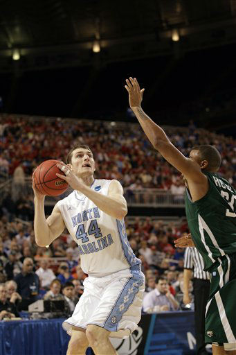 "<div class=""meta image-caption""><div class=""origin-logo origin-image ""><span></span></div><span class=""caption-text"">North Carolina Tar Heels forward Tyler Zeller shoots over Ohio Bobcats' Reggie Keely during the first half of an NCAA tournament Midwest Regional college basketball game Friday, March 23, 2012, in St. Louis.   ((AP Photo/Charlie Riedel))</span></div>"