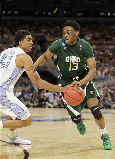 Ohio Bobcats forward T.J. Hall drives around North Carolina Tar Heels forward James Michael McAdoo during the first half of an NCAA tournament Midwest Regional college basketball game Friday, March 23, 2012, in St. Louis.  <span class=meta>(&#40;AP Photo&#47;Jeff Roberson&#41;)</span>