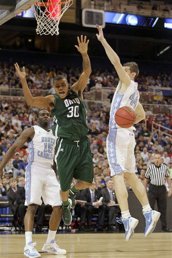 Ohio Bobcats forward Reggie Keely loses the ball as North Carolina Tar Heels&#39; P.J. Hairston, left, and Tyler Zeller defend during the first half of an NCAA tournament Midwest Regional college basketball game Friday, March 23, 2012, in St. Louis.  <span class=meta>(&#40;AP Photo&#47;Jeff Roberson&#41;)</span>