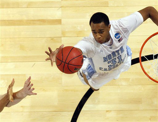 North Carolina Tar Heels forward John Henson goes for a loose ball against the Ohio Bobcats during the first half of an NCAA tournament Midwest Regional college basketball game Friday, March 23, 2012, in St. Louis.   <span class=meta>(&#40;AP Photo&#47;Jeff Roberson&#41;)</span>