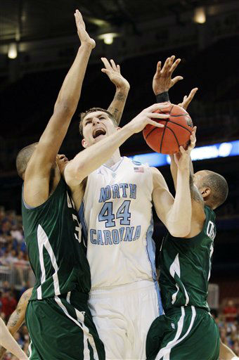 North Carolina forward Tyler Zeller &#40;44&#41; goes up for a shot against Ohio forward Reggie Keely, left, and guard Walter Offutt during the first half of an NCAA tournament Midwest Regional college basketball game, Friday, March 23, 2012, in St. Louis. <span class=meta>(&#40;AP Photo&#47;Charlie Riedel&#41;)</span>