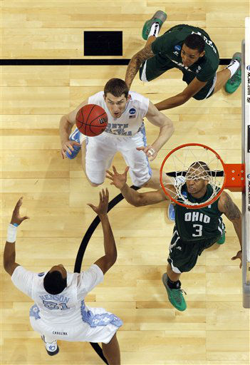 From left, North Carolina Tar Heels&#39; John Henson and Tyler Zeller reach for a rebound against Ohio Bobcats&#39; Jon Smith and Walter Offutt during the first half of an NCAA tournament Midwest Regional college basketball game Friday, March 23, 2012, in St. Louis. <span class=meta>(&#40;AP Photo&#47;Jeff Roberson&#41;)</span>