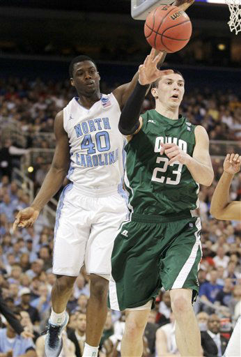 Ohio Bobcats&#39; Ivo Baltic passes as North Carolina Tar Heels&#39; Harrison Barnes defends during the first half of an NCAA tournament Midwest Regional college basketball game Friday, March 23, 2012, in St. Louis.   <span class=meta>(&#40;AP Photo&#47;Jeff Roberson&#41;)</span>