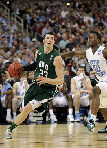Ohio Bobcats&#39; Ivo Baltic drives the ball as North Carolina Tar Heels&#39; Harrison Barnes defends during the first half of an NCAA tournament Midwest Regional college basketball game Friday, March 23, 2012, in St. Louis.  <span class=meta>(&#40;AP Photo&#47;Jeff Roberson&#41;)</span>