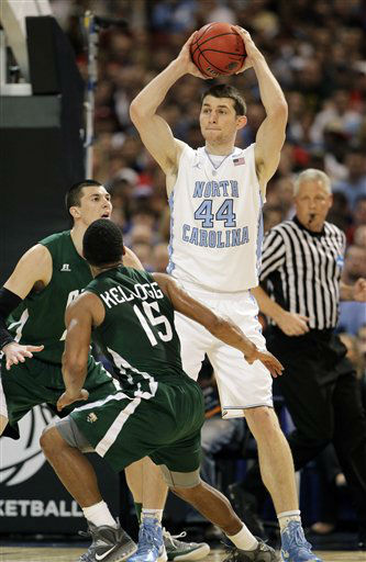 North Carolina Tar Heels&#39; Tyler Zeller passe over Ohio Bobcats&#39; Nick Kellogg and Ivo Baltic during the first half of an NCAA tournament Midwest Regional college basketball game Friday, March 23, 2012, in St. Louis.  <span class=meta>(&#40;AP Photo&#47;Jeff Roberson&#41;)</span>