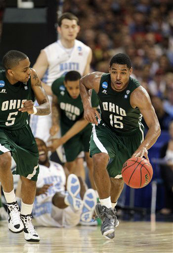 Ohio Bobcats&#39; Nick Kellogg &#40;15&#41; is followed down court by D.J. Cooper during the first half of an NCAA tournament Midwest Regional college basketball game against the North Carolina Tar Heels Friday, March 23, 2012, in St. Louis. <span class=meta>(&#40;AP Photo&#47;Jeff Roberson&#41;)</span>