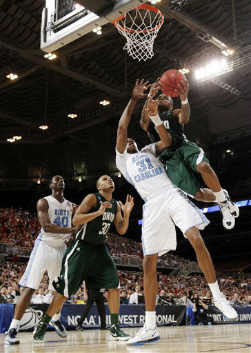 Ohio guard D.J. Cooper &#40;5&#41; shoots against North Carolina forward John Henson &#40;31&#41; during the second half of an NCAA tournament Midwest Regional college basketball game, Friday, March 23, 2012, in St. Louis. North Carolina won 73-65.  <span class=meta>(&#40;AP Photo&#47;Charlie Riedel&#41;)</span>