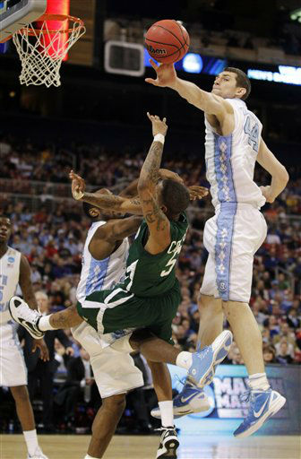 North Carolina forward Tyler Zeller &#40;44&#41; rejects a shot by Ohio guard D.J. Cooper &#40;5&#41; as North Carolina guard Justin Watts &#40;24&#41; defends during the first half of an NCAA tournament Midwest Regional college basketball game, Friday, March 23, 2012, in St. Louis. <span class=meta>(&#40;AP Photo&#47;Jeff Roberson&#41;)</span>
