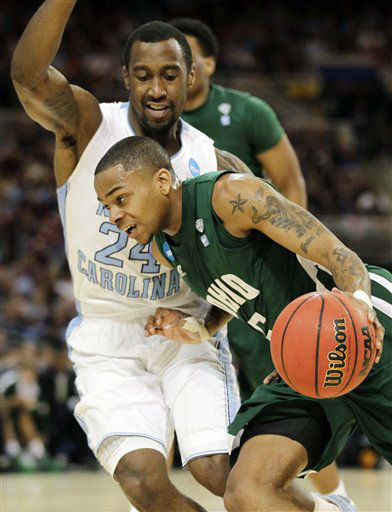 Ohio guard D.J. Cooper &#40;5&#41; drives the ball against North Carolina guard Justin Watts &#40;24&#41; during the first half of an NCAA tournament Midwest Regional college basketball game, Friday, March 23, 2012, in St. Louis.  <span class=meta>(&#40;AP Photo&#47;Jeff Roberson&#41;)</span>
