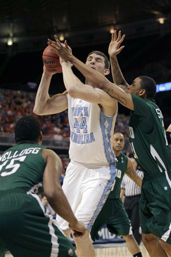 North Carolina Tar Heels forward Tyler Zeller is guarded by Ohio Bobcats&#39; Nick Kellogg &#40;15&#41; and Jon Smith during the first half of an NCAA tournament Midwest Regional college basketball game Friday, March 23, 2012, in St. Louis. <span class=meta>( &#40;AP Photo&#47;Charlie Riedel&#41;)</span>