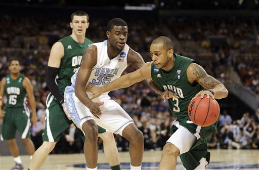 Ohio Bobcats guard Walter Offutt is defended by North Carolina Tar Heels&#39; Reggie Bullock during the first half of an NCAA tournament Midwest Regional college basketball game Friday, March 23, 2012, in St. Louis. <span class=meta>(&#40;AP Photo&#47;Jeff Roberson&#41;)</span>