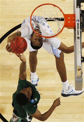 Ohio forward T.J. Hall rejects a shot by North Carolina forward John Henson during the first half of an NCAA tournament Midwest Regional college basketball game  onFriday, March 23, 2012, in St. Louis. <span class=meta>(&#40;AP Photo&#47;Jeff Roberson&#41;)</span>