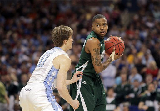 Ohio Bobcats guard D.J. Cooper looks to pass arond North Carolina Tar Heels&#39; Stilman White during the first half of an NCAA tournament Midwest Regional college basketball game Friday, March 23, 2012, in St. Louis.  <span class=meta>(&#40;AP Photo&#47;Jeff Roberson&#41;)</span>