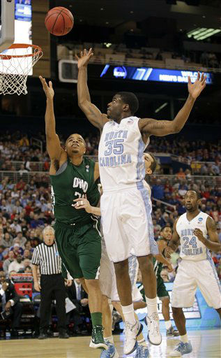 Ohio Bobcats forward Reggie Keely and North Carolina Tar Heels guard Reggie Bullock go after a loose ball during the first half of an NCAA tournament Midwest Regional college basketball game Friday, March 23, 2012, in St. Louis. <span class=meta>(&#40;AP Photo&#47;Jeff Roberson&#41;)</span>