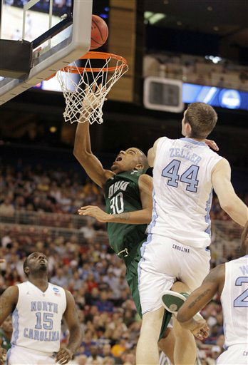 Ohio Bobcats forward Reggie Keely shoots the ball as North Carolina Tar Heels&#39; P.J. Hairston, left, and Tyler Zeller defend during the first half of an NCAA tournament Midwest Regional college basketball game Friday, March 23, 2012, in St. Louis. <span class=meta>(&#40;AP Photo&#47;Jeff Roberson&#41;)</span>