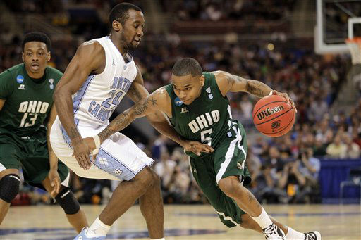 Ohio Bobcats guard D.J. Cooper drives around North Carolina Tar Heels&#39; Justin Watts as T.J. Hall looks on during the first half of an NCAA tournament Midwest Regional college basketball game Friday, March 23, 2012, in St. Louis.  <span class=meta>(&#40;AP Photo&#47;Jeff Roberson&#41;)</span>