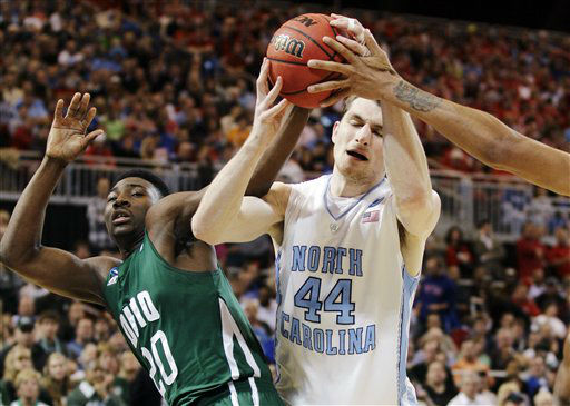 North Carolina forward Tyler Zeller &#40;44&#41; battles for a rebound against Ohio guard Ricardo Johnson &#40;20&#41; during the first half of an NCAA tournament Midwest Regional college basketball game, Friday, March 23, 2012, in St. Louis. <span class=meta>(&#40;AP Photo&#47;Charlie Riedel&#41;)</span>