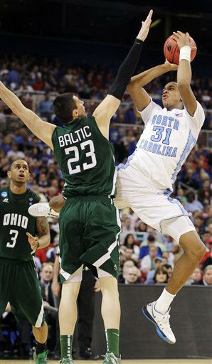 North Carolina forward John Henson &#40;31&#41; shoots against Ohio forward Ivo Baltic &#40;23&#41; during the second half of an NCAA tournament Midwest Regional college basketball game, Friday, March 23, 2012, in St. Louis. <span class=meta>(&#40;AP Photo&#47;Jeff Roberson&#41;)</span>
