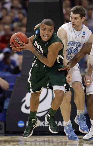 "<div class=""meta image-caption""><div class=""origin-logo origin-image ""><span></span></div><span class=""caption-text"">Ohio Bobcats' Reggie Keely looks to pass the ball against North Carolina Tar Heels' Tyler Zeller during the first half of an NCAA tournament Midwest Regional college basketball game Friday, March 23, 2012, in St. Louis. ((AP Photo/Charlie Riedel))</span></div>"