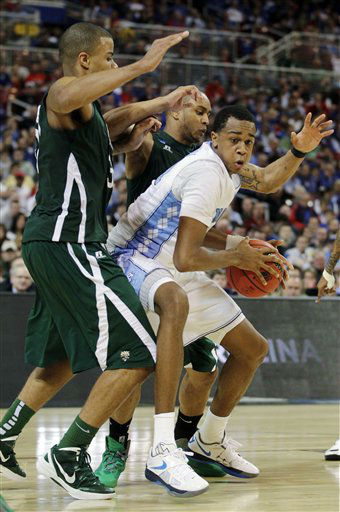 North Carolina forward John Henson &#40;31&#41; drives against Ohio forward Reggie Keely, left, and guard Walter Offutt &#40;3&#41; during the second half of an NCAA tournament Midwest Regional college basketball game, Friday, March 23, 2012, in St. Louis. <span class=meta>(&#40;AP Photo&#47;Jeff Roberson&#41;)</span>