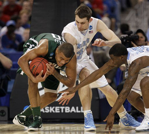 Ohio Bobcats&#39; Reggie Keely grabs a loose ball against North Carolina Tar Heels&#39; Tyler Zeller and Reggie Bullock during the first half of an NCAA tournament Midwest Regional college basketball game Friday, March 23, 2012, in St. Louis.  <span class=meta>(&#40;AP Photo&#47;Charlie Riedel&#41;)</span>