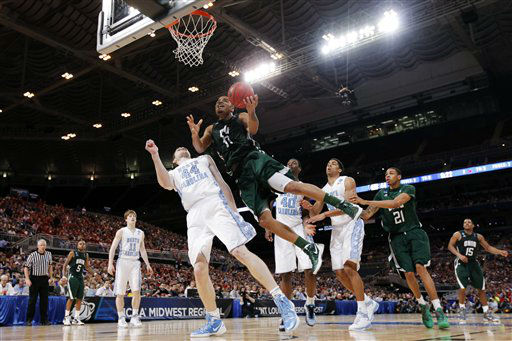 "<div class=""meta image-caption""><div class=""origin-logo origin-image ""><span></span></div><span class=""caption-text"">Ohio forward Reggie Keely (30) shoots against North Carolina forward Tyler Zeller (44) during the second half of an NCAA tournament Midwest Regional college basketball game, Friday, March 23, 2012, in St. Louis. North Carolina won 73-65.  ((AP Photo/Charlie Riedel))</span></div>"