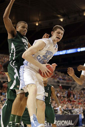 North Carolina Tar Heels&#39; Tyler Zeller grabs a rebound as Ohio Bobcats&#39; Reggie Keely defends during the first half of an NCAA tournament Midwest Regional college basketball game Friday, March 23, 2012, in St. Louis. <span class=meta>(&#40;AP Photo&#47;Charlie Riedel&#41;)</span>