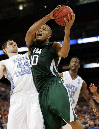 Ohio forward Reggie Keely &#40;30&#41; goes up against North Carolina forward Tyler Zeller &#40;44&#41; during the second half of an NCAA tournament Midwest Regional college basketball game, Friday, March 23, 2012, in St. Louis. North Carolina won 73-65 in overtime.  <span class=meta>(&#40;AP Photo&#47;Charlie Riedel&#41;)</span>