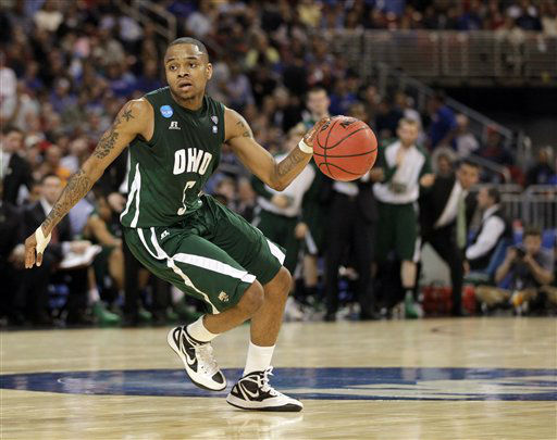 Ohio Bobcats&#39; D.J. Cooper dribbles the ball against the North Carolina Tar Heels during the first half of an NCAA tournament Midwest Regional college basketball game Friday, March 23, 2012, in St. Louis.  <span class=meta>(&#40;AP Photo&#47;Jeff Roberson&#41;)</span>