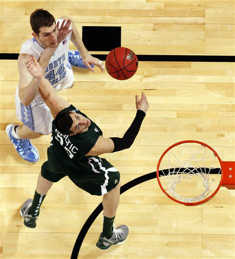 North Carolina forward Tyler Zeller &#40;44&#41; and Ohio forward Ivo Baltic &#40;23&#41; battle for a rebound during the second half of an NCAA tournament Midwest Regional college basketball game, Friday, March 23, 2012, in St. Louis. North Carolina won 73-65 in overtime. <span class=meta>(&#40;AP Photo&#47;Jeff Roberson&#41;)</span>