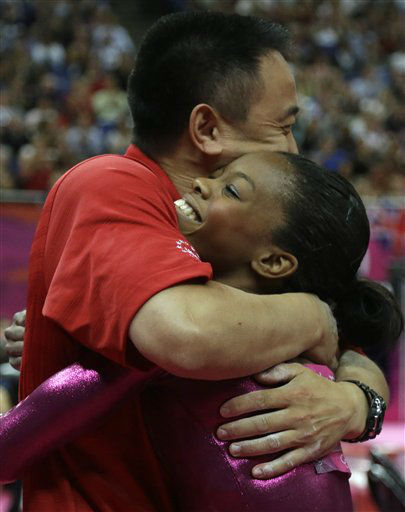 U.S. gymnast Gabrielle Douglas is hugged by coach Liang Chow after her final and deciding performance on the floor during the artistic gymnastics women&#39;s individual all-around competition at the 2012 Summer Olympics, Thursday, Aug. 2, 2012, in London. <span class=meta>(AP Photo&#47; Julie Jacobson)</span>