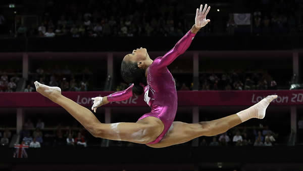 U.S. gymnast Gabrielle Douglas performs on the balance beam during the artistic gymnastics women&#39;s individual all-around competition at the 2012 Summer Olympics, Thursday, Aug. 2, 2012, in London.  <span class=meta>(AP Photo&#47; Gregory Bull)</span>