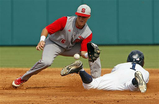 Rice&#39;s Leon Byrd &#40;1&#41; beats the throw from catcher to North Carolina State&#39;s Logan Ratledge &#40;6&#41; during the second inning of an NCAA college baseball tournament super regional game, Saturday, June 8, 2013, in Raleigh, N.C. &#40;AP Photo&#47;Karl B DeBlaker&#41; <span class=meta>(AP Photo&#47; Karl B DeBlaker)</span>