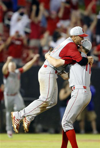 North Carolina State&#39;s Tarran Senay &#40;32&#41; jumps into the arms of pitcher Ethan Ogburn &#40;10&#41; after Rice&#39;s final out of the 17th inning of an NCAA college baseball tournament super regional game, Sunday, June 9, 2013, in Raleigh, N.C. North Carolina State won 5-4 in 17 innings. &#40;AP Photo&#47;Karl B DeBlaker&#41; <span class=meta>(AP Photo&#47; Karl B DeBlaker)</span>