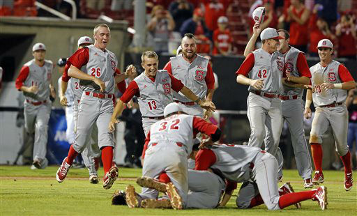 North Carolina State players come to join Tarran Senay, Trea Turner, and Ethan Ogburn, in the infield following State&#39;s 5-4 win over Rice in 17 innings of an NCAA college baseball tournament super regional game, Sunday, June 9, 2013, in Raleigh, N.C. &#40;AP Photo&#47;Karl B DeBlaker&#41; <span class=meta>(AP Photo&#47; Karl B DeBlaker)</span>