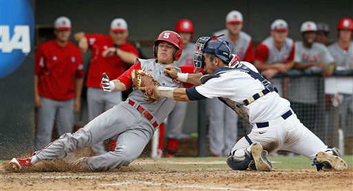 North Carolina State&#39;s Logan Ratledge &#40;6&#41; gets tagged out by Rice catcher Hunter Kopycinski &#40;4&#41; during the seventh inning of an NCAA college baseball tournament super regional game, Sunday, June 9, 2013, in Raleigh, N.C. &#40;AP Photo&#47;Karl B DeBlaker&#41; <span class=meta>(AP Photo&#47; Karl B DeBlaker)</span>