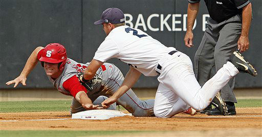 North Carolina State&#39;s Brett Williams, left, gets caught trying to steal third by Rice&#39;s Shane Hoelscher &#40;2&#41; during the second inning of an NCAA college baseball tournament super regional game on Sunday, June 9, 2013, in Raleigh, N.C. &#40;AP Photo&#47;Karl B DeBlaker&#41; <span class=meta>(AP Photo&#47; Karl B DeBlaker)</span>