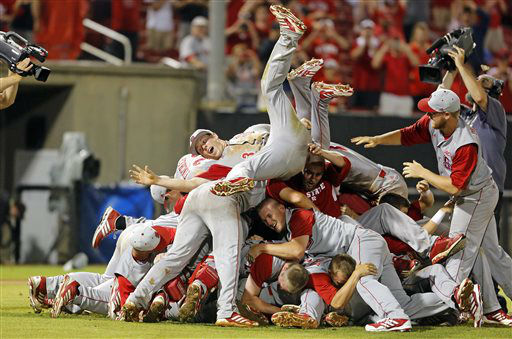 North Carolina State&#39;s Brett Williams &#40;3&#41; jumps on top of the pile of teammates following State&#39;s 5-4 win over Rice in the 17th inning of an NCAA college baseball tournament super regional game, Sunday, June 9, 2013, in Raleigh, N.C. &#40;AP Photo&#47;Karl B DeBlaker&#41; <span class=meta>(AP Photo&#47; Karl B DeBlaker)</span>
