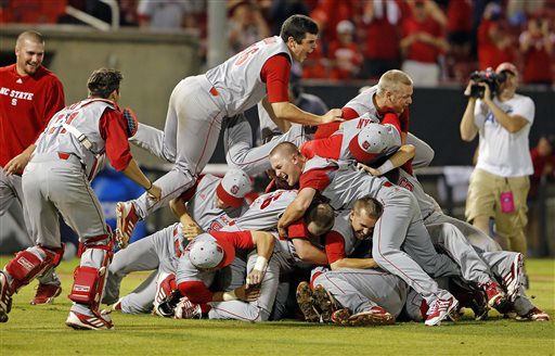 North Carolina State&#39;s Carlos Rodon &#40;16&#41; jumps on top of teammates as they celebrate their 5-4 win over Rice in the 17th inning of an NCAA college baseball tournament super regional game, Sunday, June 9, 2013, in Raleigh, N.C. &#40;AP Photo&#47;Karl B DeBlaker&#41; <span class=meta>(AP Photo&#47; Karl B DeBlaker)</span>