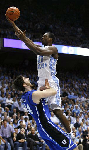 North Carolina&#39;s Harrison Barnes, top, drives for a basket as Duke&#39;s Ryan Kelly defends during the first half of an NCAA college basketball game in Chapel Hill, N.C., Wednesday, Feb. 8, 2012.  <span class=meta>(AP Photo&#47; Gerry Broome)</span>