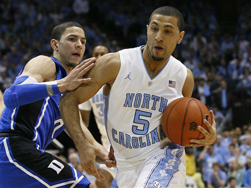 North Carolina&#39;s Kendall Marshall &#40;5&#41; drives to the basket as Duke&#39;s Austin Rivers defends during the first half of an NCAA college basketball game in Chapel Hill, N.C., Wednesday, Feb. 8, 2012.  <span class=meta>(AP Photo&#47; Gerry Broome)</span>