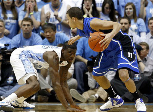 North Carolina&#39;s Reggie Bullock, left, guards Duke&#39;s Seth Curry during the first half of an NCAA college basketball game in Chapel Hill, N.C., Wednesday, Feb. 8, 2012.  <span class=meta>(AP Photo&#47; Gerry Broome)</span>