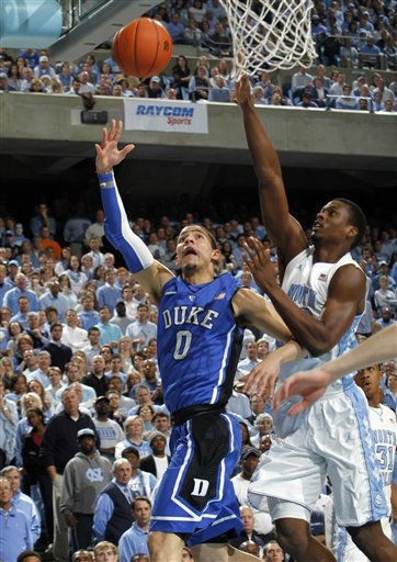 Duke guard Austin Rivers &#40;0&#41; drives to the basket against North Carolina forward Harrison Barnes during the first half of an NCAA college basketball game in Chapel Hill, N.C., Wednesday, Feb. 8, 2012.  <span class=meta>(AP Photo&#47; Jim R. Bounds)</span>