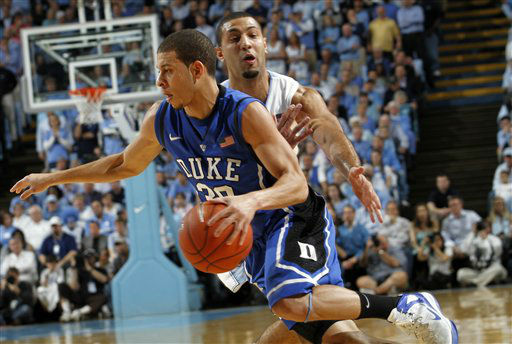 "<div class=""meta ""><span class=""caption-text "">Duke guard Seth Curry (30) drives to the basket on North Carolina's guard Kendall Marshall during the first half of an NCAA college basketball game in Chapel Hill, N.C., Wednesday, Feb. 8, 2012.  (AP Photo/ Jim R. Bounds)</span></div>"